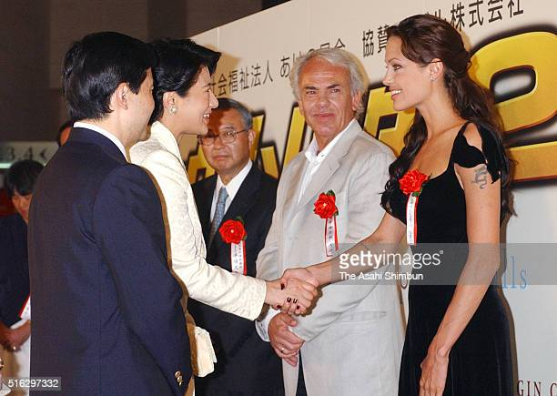 Crown Prince Naruhito and Crown Princess Masako meet Angelina Jolie during the 'Lara Croft Tomb Raider The Cradle of Life' Special Screening on...