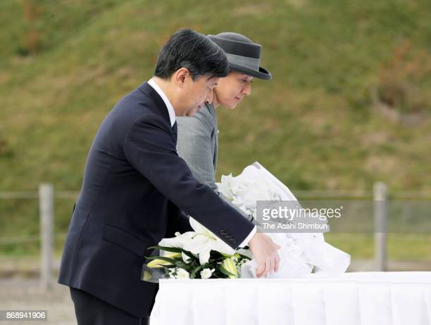 Crown Prince Naruhito and Crown Princess Masako offer flowers at a monument to commemorate the victims of the Great East Japan Earthquake on November...