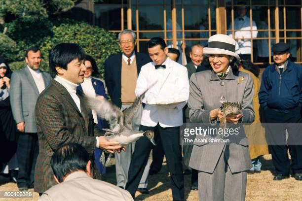Crown Prince Naruhito and Crown Princess Masako release ducks during the reception inviting foreign diplomats at Shinhama Kamoba Imperial Wild Duck...