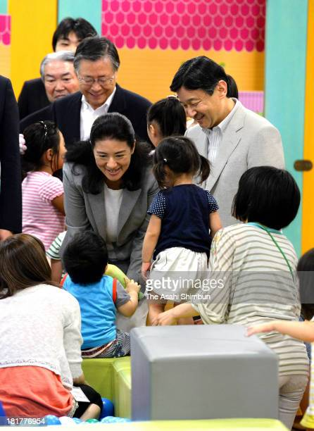 Crown Prince Naruhito and Crown Princess Masako speak to children at indoor playing field 'PEP Kids Koriyama' on September 22 2013 in Koriyama...