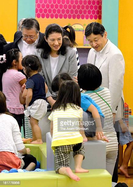 Crown Prince Naruhito and Crown Princess Masako speak to children at indoor playing field 'PEP Kids Koriyama' on September 22 2013 in Koriyama...