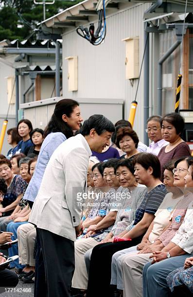 Crown Prince Naruhito and Crown Princess Masako speak to evacuees of 2011 Great East Japan earthquake and subsequesnt tsunami at a temporary housing...