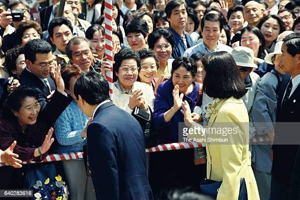 Crown Prince Naruhito and Crown Princess Masako talk to wellwishers at Nakamise street of Asakusa on April 22 1999 in Tokyo Japan