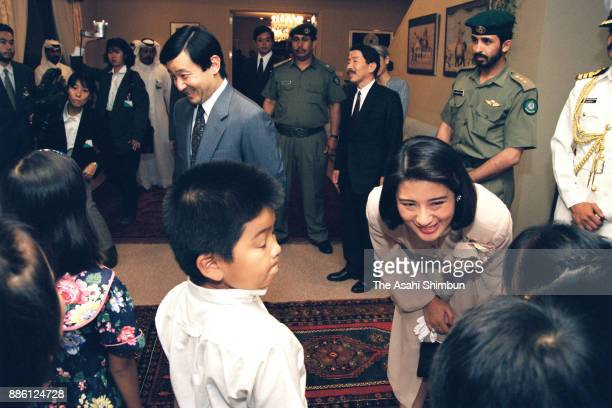Crown Prince Naruhito and Crown Princess Masako talk with Japanese living in Qatar at Japanese Ambassador's official residence on November 12 1994 in...