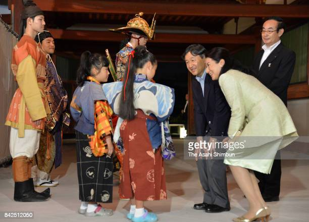 Crown Prince Naruhito and Crown Princess Masako talk with participants of the National Cultural Festival Opening Ceremony at Todaiji Temple on...