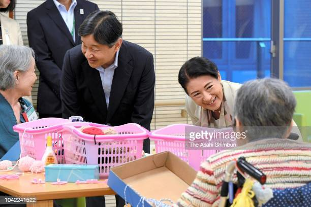 Crown Prince Naruhito and Crown Princess Masako watch a session at a nursing home for elderly people on September 21 2018 in Tokyo Japan