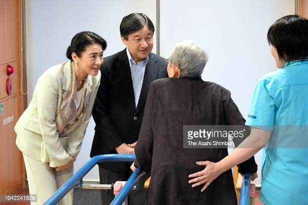 Crown Prince Naruhito and Crown Princess Masako talk with residents at a nursing home for elderly people on September 21 2018 in Tokyo Japan