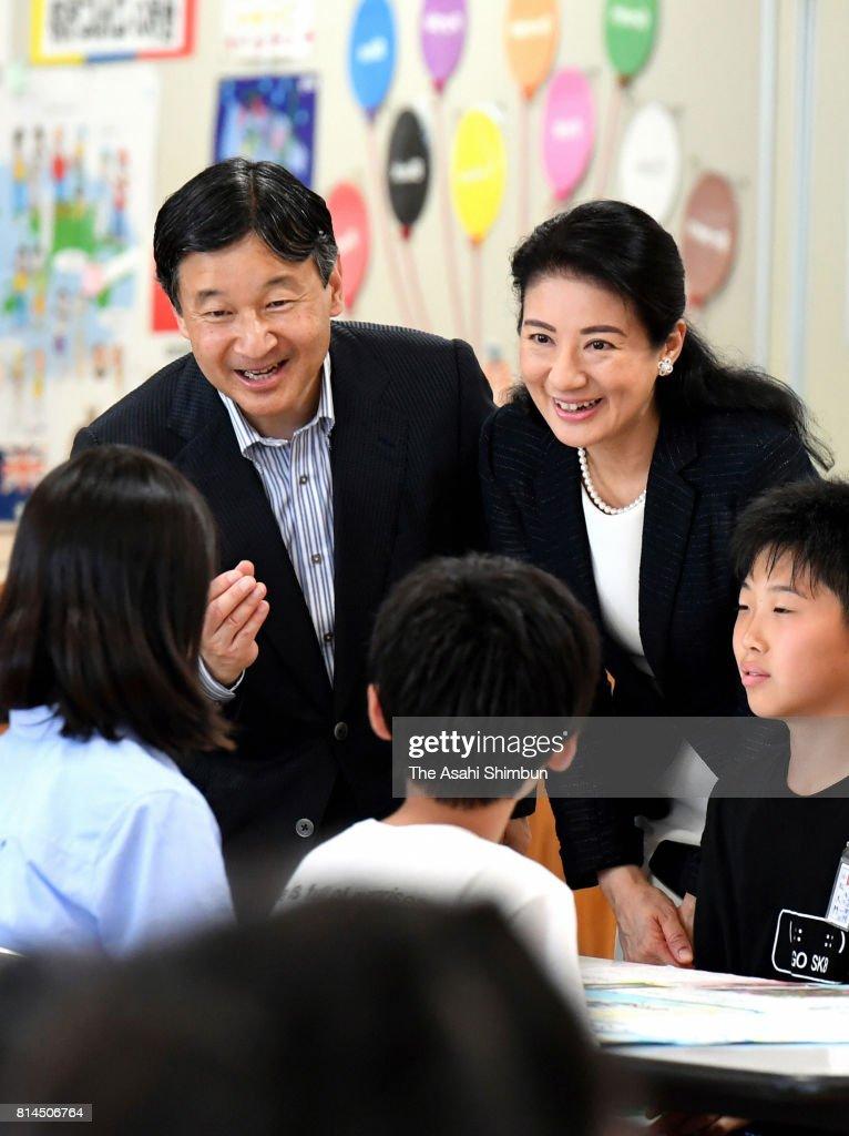 Crown Prince Naruhito and Crown Princess Masako talk with school children at Otoyo Elementary School on July 11, 2017 in Katagami, Akita, Japan.