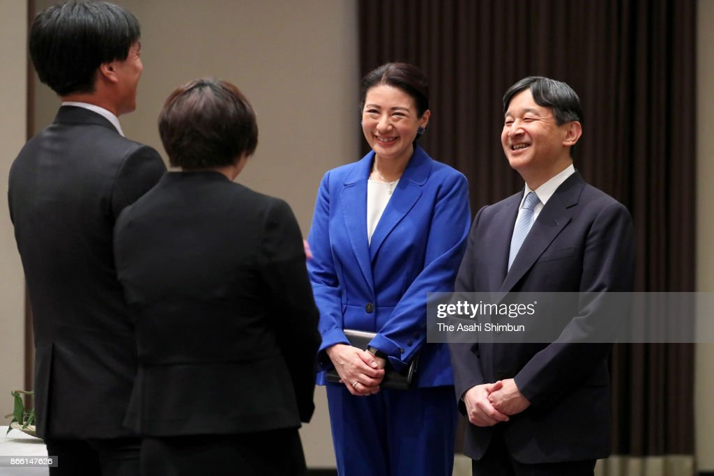 Crown Prince Naruhito and Crown Princess Masako talk with youth farmers during their meeting on October 24, 2017 in Kochi, Japan.
