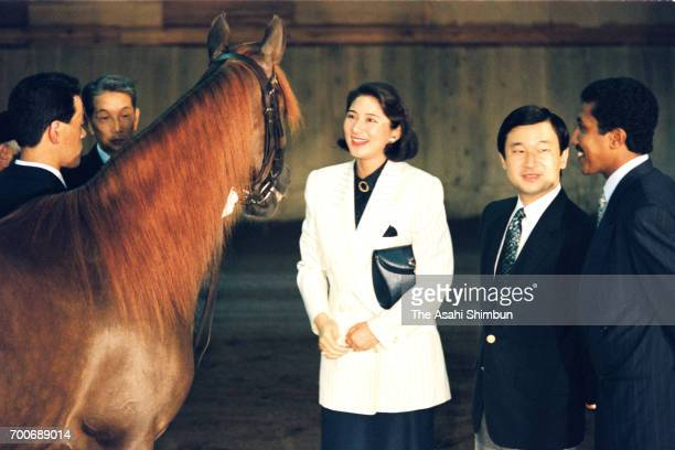Crown Prince Naruhito and Crown Princess Masako watch a horse presented by King Qaboos bin Said al Said of Oman at the Imperial Palace on July 6 1995...