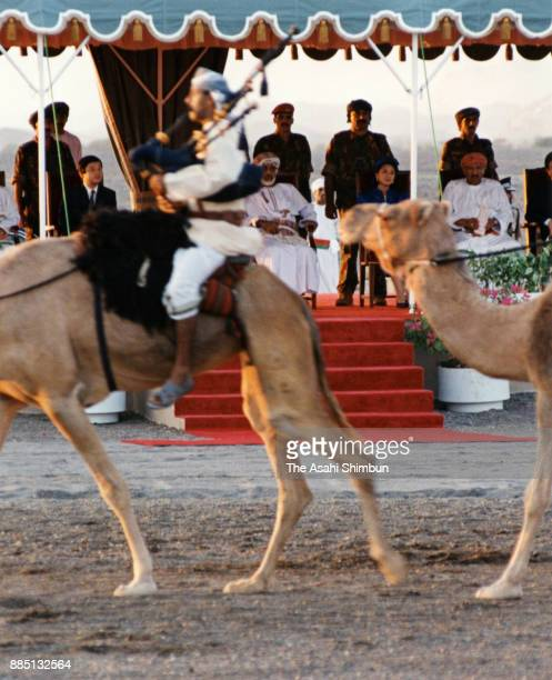 Crown Prince Naruhito and Crown Princess Masako watch camel attraction with Sultan Qaboos bin Said al Said of Oman on November 10 1994 in Nizwa Oman