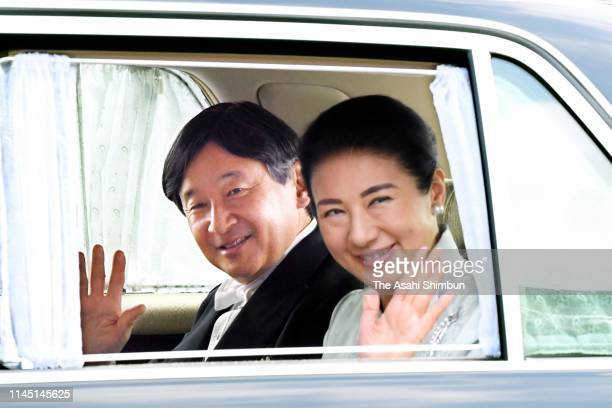 Crown Prince Naruhito and Crown Princess Masako wave to reporters on arrival at the Imperial Palace for the 'Shurai' rehearsal of his enthronement...