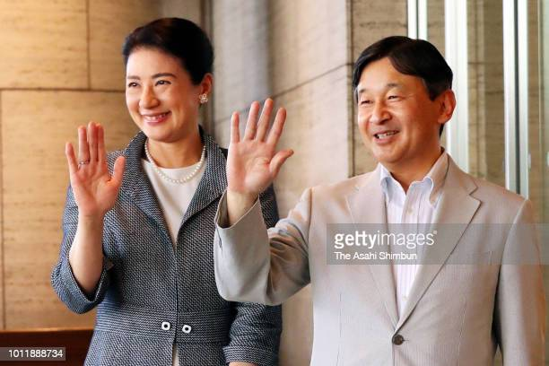 Crown Prince Naruhito and Crown Princess Masako wave to well-wishers on arrival at a hotel on August 4, 2018 in Kobe, Japan.