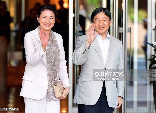 Crown Prince Naruhito and Crown Princess Masako wave to well-wishers on arrival at a hotel on September 25, 2018 in Fukuoka, Japan.
