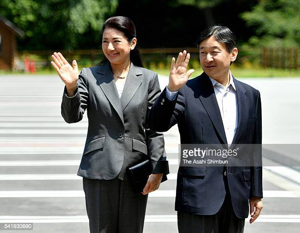 Crown Prince Naruhito and Crown Princess Masako wave to wellwishers on arrival at the Jogahama Visitor Center on June 21 2016 in Miyako Iwate Japan...