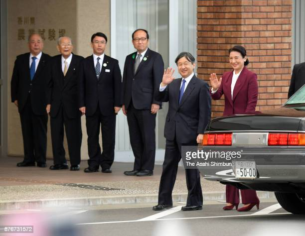 Crown Prince Naruhito and Crown Princess Masako wave to wellwishers on arrival at the Kagawa Prefecture Agricultural Experiment Station on November...