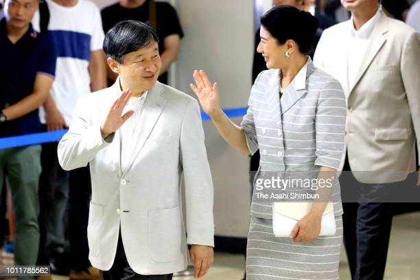 Crown Prince Naruhito and Crown Princess Masako waver to wellwishers on departure at Itami Airport on August 5 2018 in Toynaka Osaka Japan