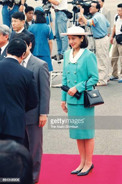 Crown Prince Naruhito and Crown Princess Masako welcome Emperor Akihito and Empress Michiko at Haneda Airport on September 19 1993 in Tokyo Japan