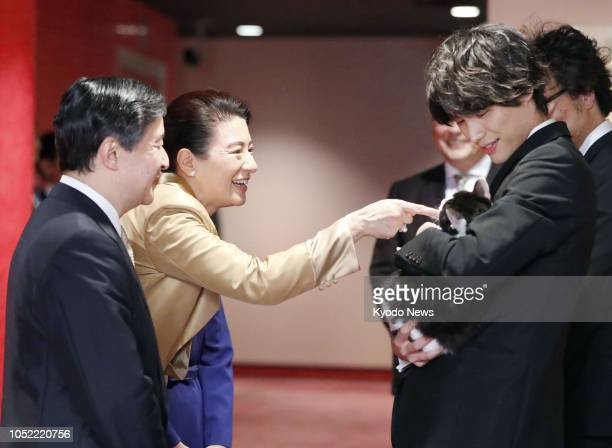 Crown Prince Naruhito and his wife Crown Princess Masako chat with actor Sota Fukushi before watching a movie he stars in featuring a cat at a...