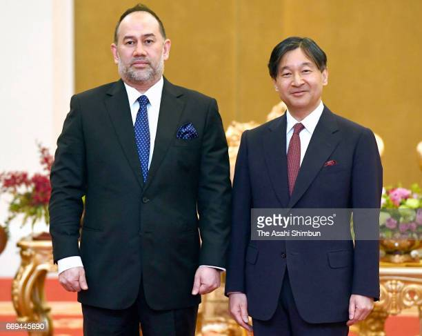 Crown Prince Naruhito and King Sultan Muhammad V of Malaysia pose for photographs during their meeting at the Istana Negara on April 16 2017 in Kuala...