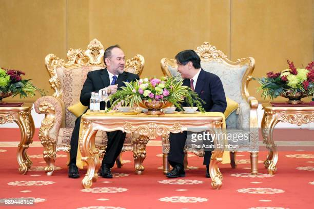Crown Prince Naruhito and King Sultan Muhammad V of Malaysia talk during their meeting at the Istana Negara on April 16 2017 in Kuala Lumpur Malaysia...