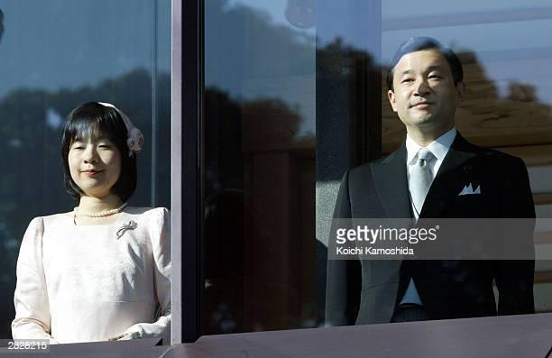 Crown Prince Naruhito and Princess Sayako celebrate Emperor Akihito's 70th birthday at the Imperial Palace December 23 2003 in Tokyo Japan