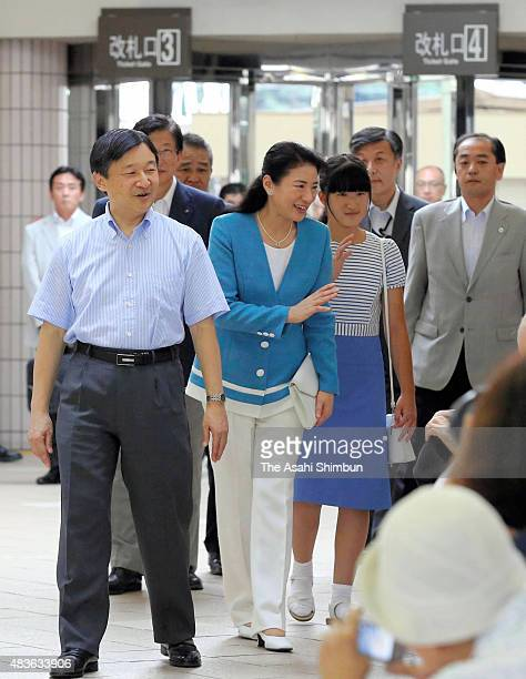 Crown Prince Naruhito Crown Princess Masako and Princess Aiko are seen upon arrival at Izukyu Shimoda Station on August 11 2015 in Shimoda Shizuoka...