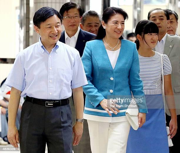 Crown Prince Naruhito Crown Princess Masako and Princess Aiko are seen upon arrival at Izukyu Shimoda Station on August 11 2015 in Shimoda Shizuoka...