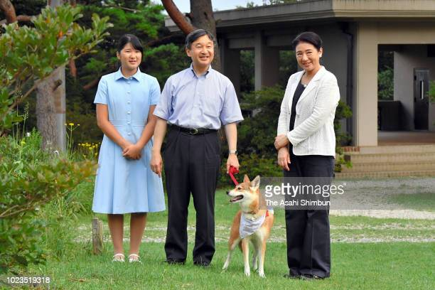 Crown Prince Naruhito Crown Princess Masako and Princess Aiko stroll with their dog Yuri outside Nasu Imperial Villa on August 25 2018 in Nasu...