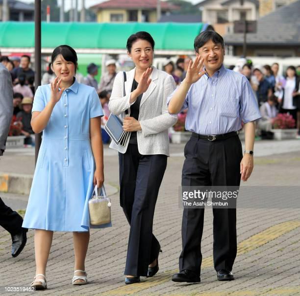 Crown Prince Naruhito, Crown Princess Masako and Princess Aiko wave to well-wishers on arrival at Nasushiobara Station on their way to the Nasu...