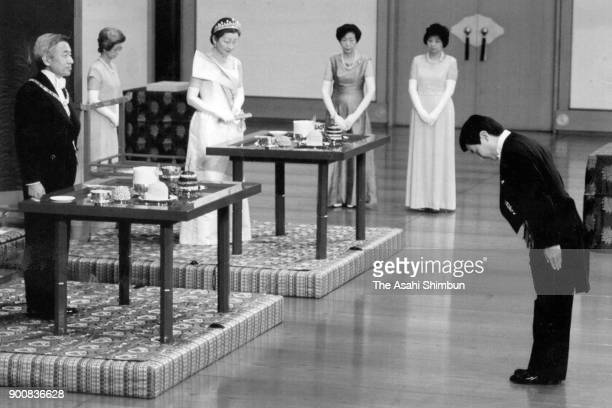 Crown Prince Naruhito greets Emperor Akihito and Empress Michiko after the Ceremonial Investiture at the Imperial Palace on February 23 1991 in Tokyo...
