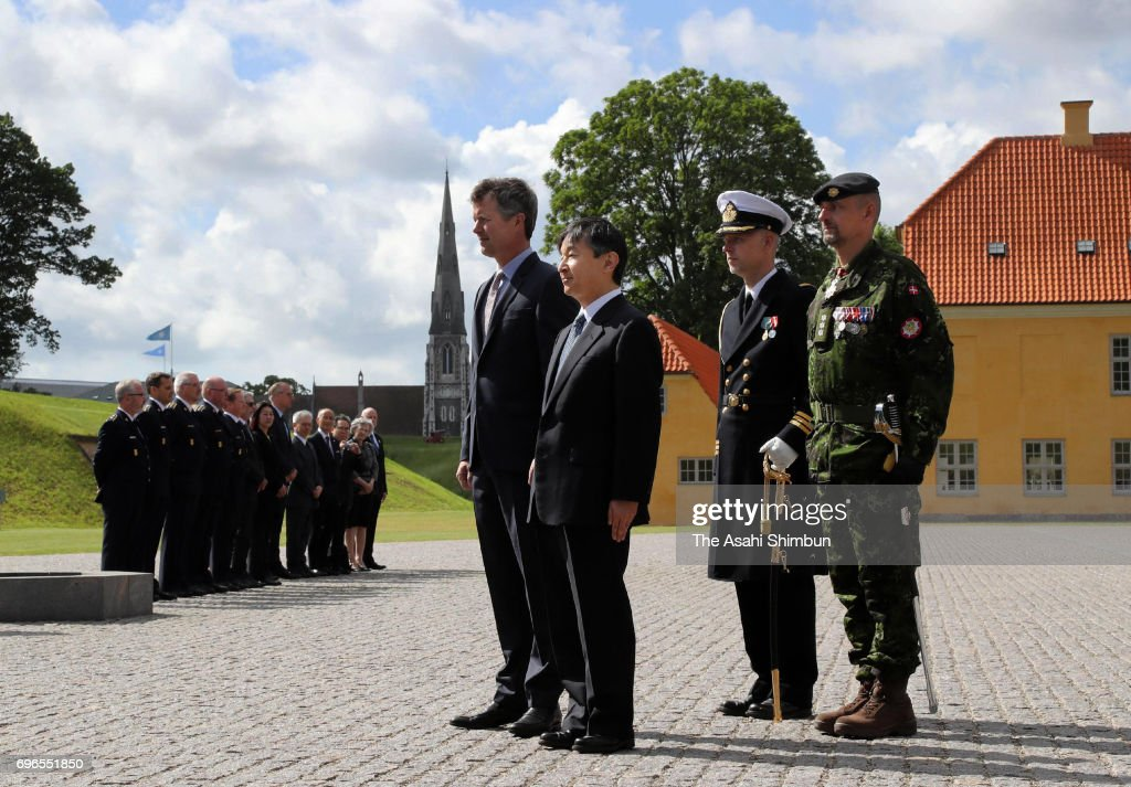 Crown Prince Naruhito of Japan and Crown Prince Frederik of Denmark offer a wreath at the Monument for Denmark's International Effort on June 16, 2017 in Copenhagen, Denmark.
