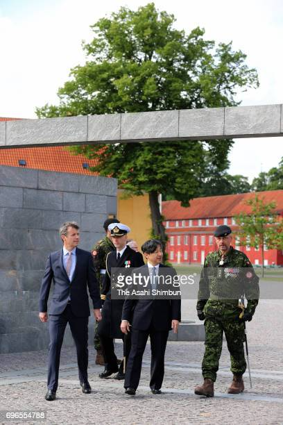 Crown Prince Naruhito of Japan and Crown Prince Frederik of Denmark walk after offering a wreath at the Monument for Denmark's International Effort...