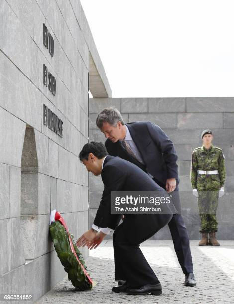 Crown Prince Naruhito of Japan and Crown Prince Frederik of Denmark offer a wreath at the Monument for Denmark's International Effort on June 16 2017...
