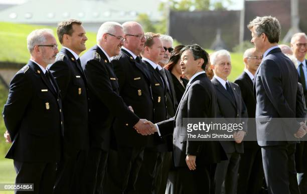 Crown Prince Naruhito of Japan and Crown Prince Frederik of Denmark talk with those engaged in rescue and support operation after the Great East...