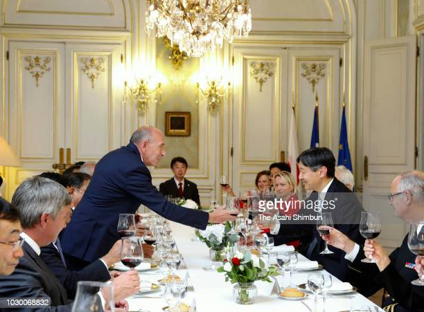 Crown Prince Naruhito of Japan and French Interior Minister Gerard Collomb toast glasses during their dinner on September 8 2018 in Lyon France