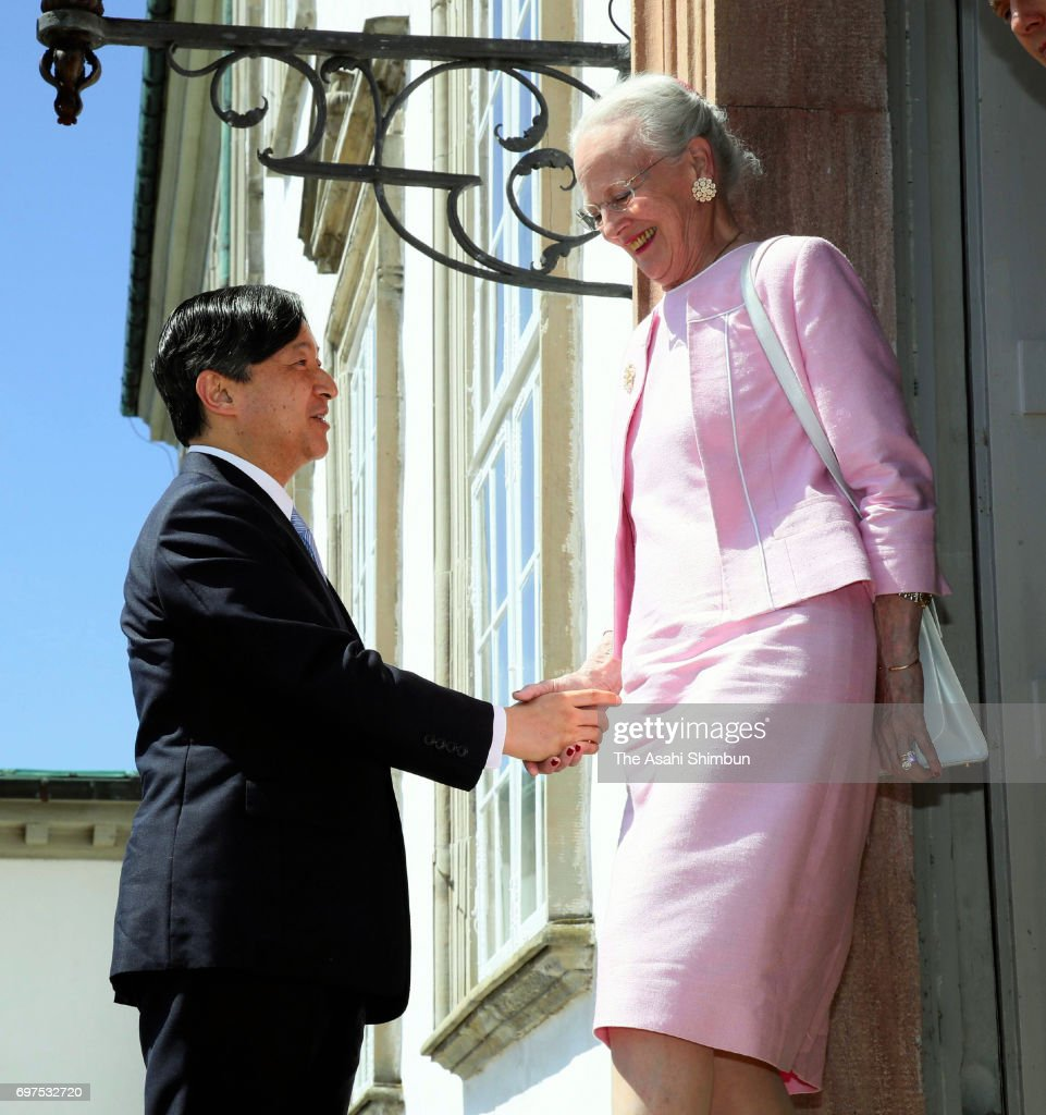 Crown Prince Naruhito of Japan (L) and Queen Margrethe II of Denmark (R) shake hands on arrival at Fredensborg Palace on June 18, 2017 in Fredensborg, Denmark.