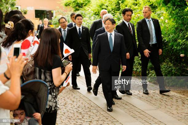 Crown Prince Naruhito of Japan gestures to bystanders as he arrives to the H C Andersen Museum in Odense on June 19 2017 Crown Prince Naruhito is...