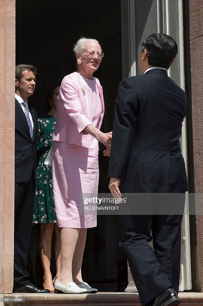 Crown Prince Naruhito of Japan (R) is welcomed by Queen Margrethe II of Denmark (C), her son Crown Prince Frederik of Denmark (L) and Crown Princess Mary of Denmark as he visits Fredensborg Castle in Fredensborg, Denmark, on June 18, 2017. He is being shown around by artist and architect Hiroshi Sambuichi (R). Crownprince Naruhito is officially visiting Denmark to mark the 150th anniversary of the Danish-Japanese diplomatic relationship. / AFP PHOTO / Scanpix Denmark / Keld Navntoft / Denmark OUT