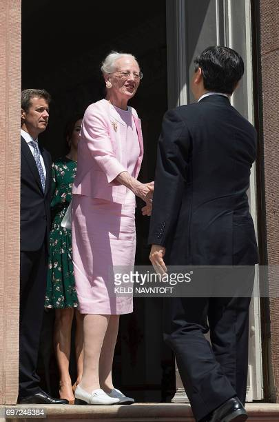 Crown Prince Naruhito of Japan is welcomed by Queen Margrethe II of Denmark her son Crown Prince Frederik of Denmark and Crown Princess Mary of...