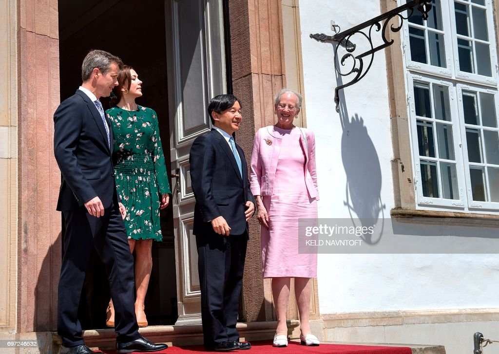 Crown Prince Naruhito of Japan (2nd R) is welcomed by Queen Margrethe II of Denmark (R), her son Crown Prince Frederik of Denmark (L) and Crown Princess Mary of Denmark as he visits Fredensborg Castle in Fredensborg, Denmark, on June 18, 2017. He is being shown around by artist and architect Hiroshi Sambuichi (R). Crownprince Naruhito is officially visiting Denmark to mark the 150th anniversary of the Danish-Japanese diplomatic relationship. / AFP PHOTO / Scanpix Denmark / Keld Navntoft / Denmark OUT