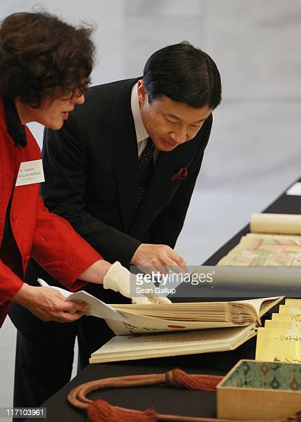H Crown Prince Naruhito of Japan looks at documents including the Treay of Amity Commerce and Navigation between Japan and Prussia from 1861 with...