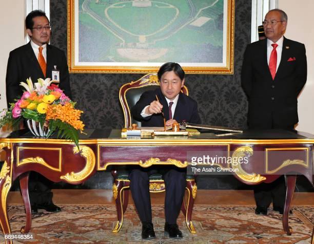 Crown Prince Naruhito of Japan signs at the Istana Negara on April 16 2017 in Kuala Lumpur Malaysia Crown Prince is 5day tour to Malaysia to mark the...