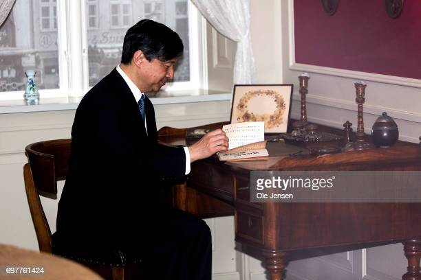 Crown Prince Naruhito of Japan sits at the original writing table in the study of famous Danish 19th century fairy tale author H C Andersen on June...