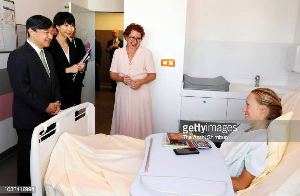 Crown Prince Naruhito of Japan talks with a patient during his visit at the Necker-Enfants Malades Hospital on September 12, 2018 in Paris, France.