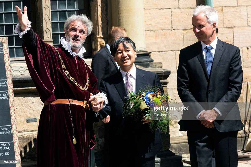 Crown Prince Naruhito of Japan (C) visits Kronborg Castle on June 17, 2017, Elsinore, Denmark. One of the actors (L) explains the Crown Prince (C) about the famous castle. Crown Prince Naruhito is on a 6-day visit to Denmark to commemorate 150 years of diplomatic ties. Kronborg Castle is a UNESCO World Heritage Site.