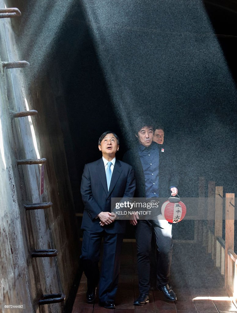 Crown Prince Naruhito of Japan (L) visits the Cisterns in Copenhagen, Denmark, on June 18, 2017. He is being shown around by artist and architect Hiroshi Sambuichi (R). Crownprince Naruhito is officially visiting Denmark to mark the 150th anniversary of the Danish-Japanese diplomatic relationship. / AFP PHOTO / Scanpix Denmark / Keld Navntoft / Denmark OUT