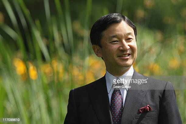 Crown Prince Naruhito of Japan walks in the gardens of Bellevue Palace with German President Christian Wulff after planting a cherry tree together on...