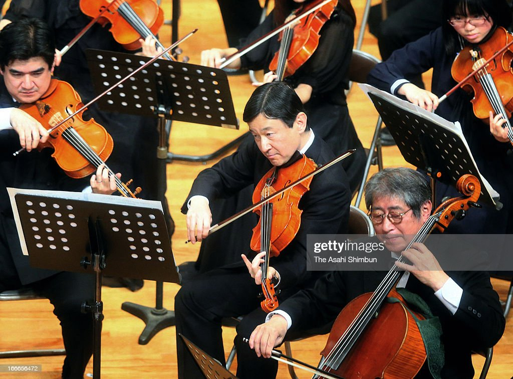 Crown Prince Naruhito (C) plays the viola during the All Gakushuin University Orchestra Concert at Gakushuin University on April 14, 2013 in Tokyo, Japan.