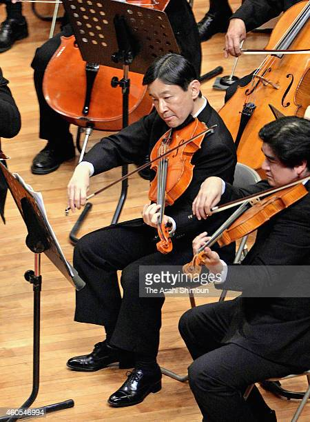 Crown Prince Naruhito plays the viola during the All Gakushuin University Orchestra Concert at Gakushuin University on December 13 2014 in Tokyo Japan